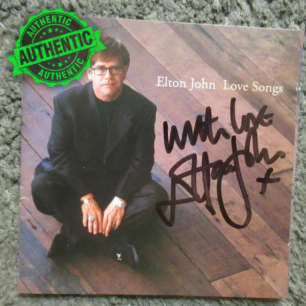 """Elton John signed """"LOVE SONGS"""" CD booklet 1996"""